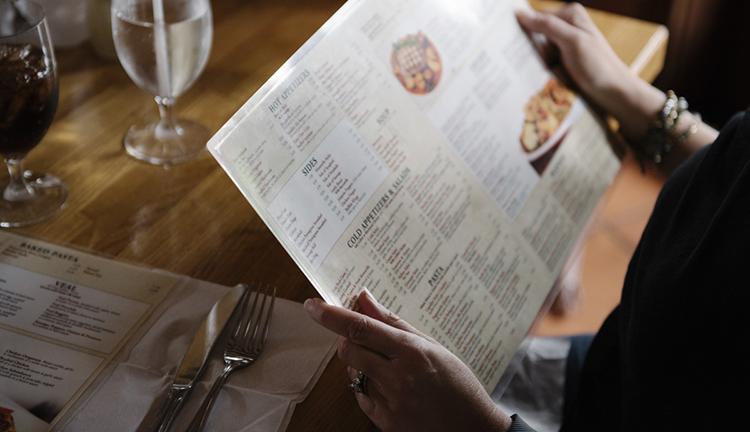 Woman looking at menu in restaurant